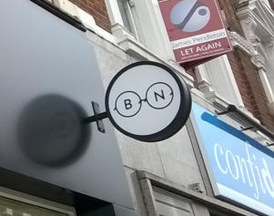 circular light box sign, London SW4