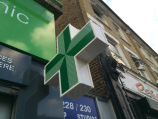 pharmacy cross sign, London W12